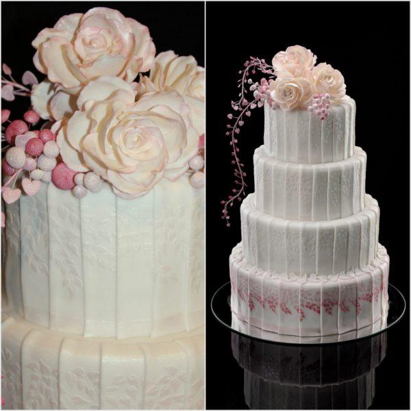Keturių aukštų švelniai rožinis tortas su rožėm
