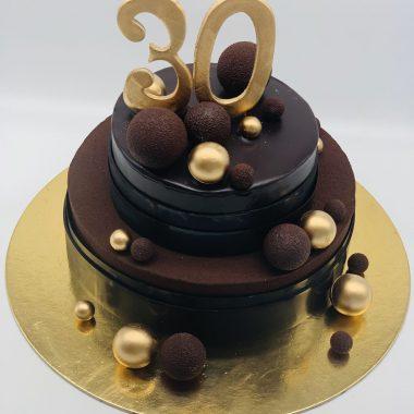 2 aukštų tortas su auksiniais ir šokoladiniais burbulais